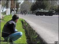 A man looks at a tank on a Tashkent road