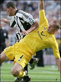 Tottenham's Sean Davis tackles Jermaine Jenas