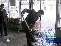 Image from Russian TV channel NTV shows the blast site at the marketplace in Tashkent, 29 March