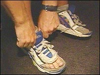 Bob Brown putting his trainers on in preparation for the final day