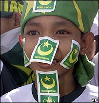 Young boy at a Indonesian campaign rally