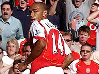 Thierry Henry celebrates scoring in Arsenal's record-equalling victory