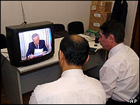 Uzbek watch a speech on the violence by President Islam Karimov