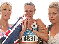 Paula Radcliffe is helped to her feet