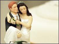 Figures on wedding cake, BBC