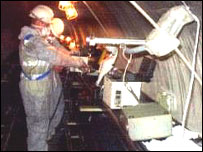 Engineers inside the damaged tunnel