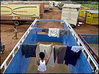 A trucker hangs out his laundry in the back of an empty vehicle