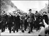 General Charles de Gaulle leads a parade in Paris