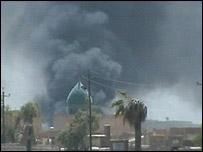 Smoke rises near the Imam Ali Shrine in Najaf