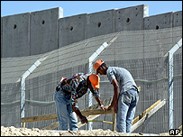 Men working on the West Bank barrier