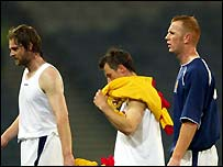 Scotland's players walk off dejected at the final whistle