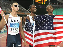 Jeremy Wariner (left) celebrates with Otis Harris (middle) and Derrick Brew