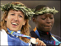Cameroon's Francoise Mbango Etone (right) next to Greek silver medallist Hrysopiyi Devezi