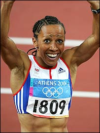 Kelly Holmes raises her arms in triumph