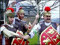 The three protestors dressed up as Roman gladiators