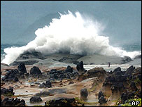 Waves from Typhoon Aere crash against the sandstone shoreline Tuesday morning, Aug. 24, 2004, outside of the eastern port city of Keelung, Taiwan
