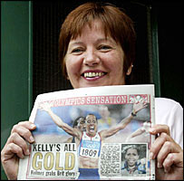 Kelly Holmes' mother with a newspaper
