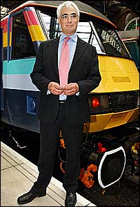 Transport Minister Alistair Darling stands in front of the new Raewald train