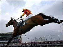 Tiutchev clears the last fence in the Martell Cognac Cup Chase