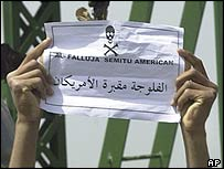 Falluja youth holding sign after attack on US contractors 31 March 2004
