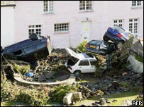 Cars thrown about by flash floods in the Cornish town of Boscastle