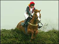 Carrie Ford steers Forest Gunner over the last fence