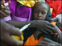 Girl being vaccinated on the Chad-Sudan border