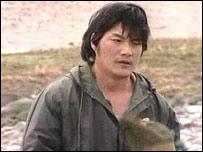 Chinese cockler at Morecambe Bay