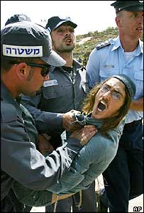 A Jewish settler is carried away by police