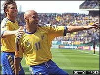 Henrik Larsson celebrates a goal for Sweden