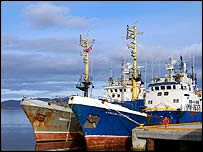 Arctic trawlers in harbour   A Kirby