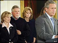 Sharon Rocha, (left) mother of pregnant murder victim Laci Peterson, and her husband Ron Grantski behind President Bush