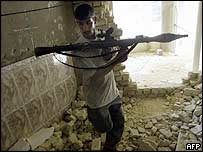 An Iraqi militant loyal to radical Shia Muslim cleric Moqtada Sadr takes position in central Najaf