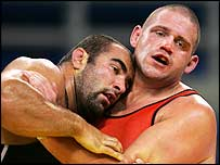 Rulon Gardner (right) gets to grips with Marek Mikulski