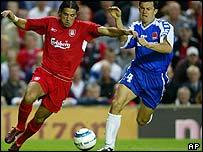 Liverpool's Milan Baros holds off Mario Tokic of Graz AK