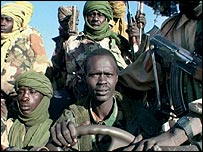 Members of Sudan's SLM/A surround Minni Minnawi in a truck