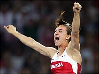 Yelena Isinbayeva celebrates setting a new world record in the pole vault