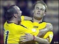 Ian Harty celebrates with goalscorer Aron Wilford
