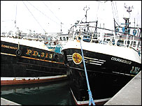 The Courageous III, rights, with pair trawler Rosemount