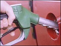 Man filling up car with petrol (generic)