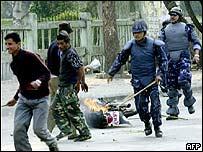 Police chasing demonstrators in Kathmandu