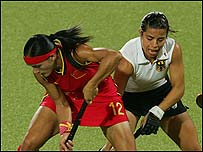 Wanfeng Zhou (left) of China and Silke Mueller of Germany compete for the ball