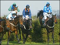 Cassia Heights (right) clears the last fence in the Topham Chase