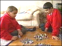 Hassan playing with his brother