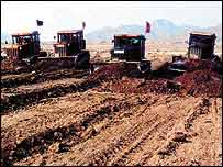 Bulldozers in mud   Unep