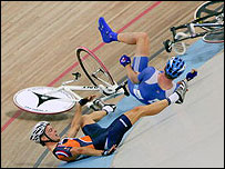 Rob Hayles (top) and Dutch rider Robert Slippens crash after colliding in the madison