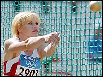 Russia's Olga Kuzenkova competes in the hammer in Athens