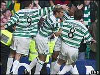 Celtic scorer Didier Agathe is mobbed by team-mates