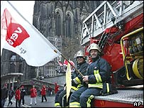 Firemen join a protest in Cologne