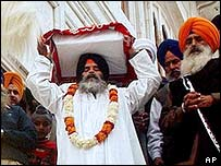 Sikh carrying copy of Guru Granth Sahib